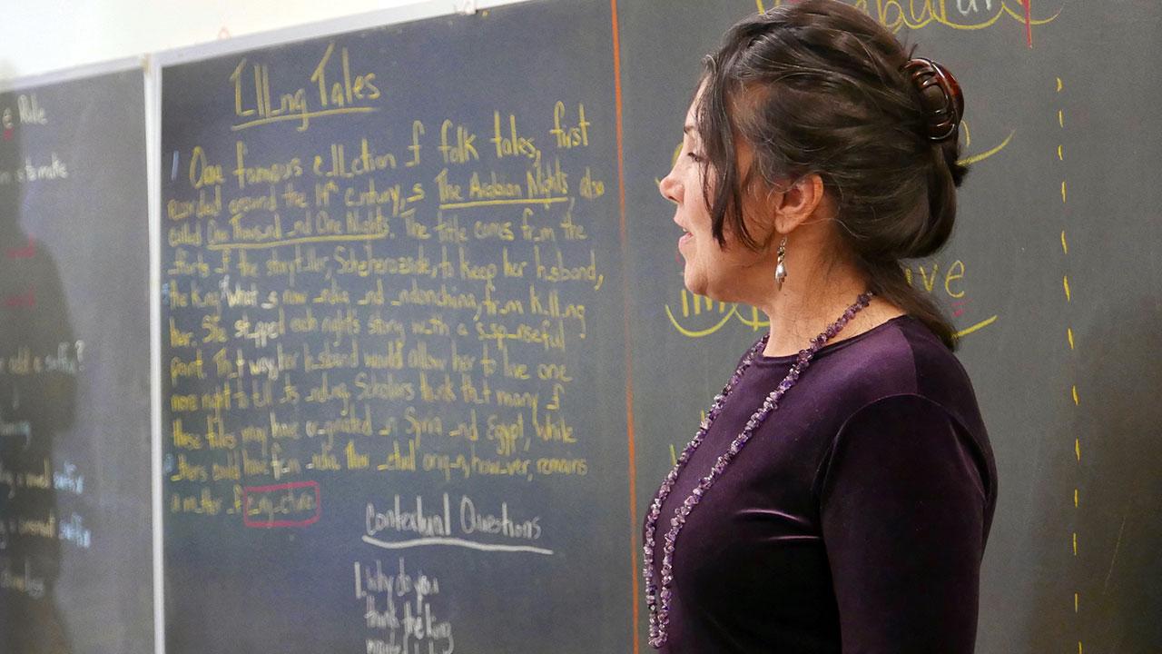 Lewis School teacher at blackboard